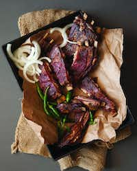 "Mesquite Smoked Lamb Ribs from ""Cowboy Barbecue: Fire & Smoke from the Original Texas Vaqueros"" by Adrian Davila(Pauline Stevens/Special Contributor)"