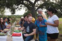 Adrian Davila's family and friends gather in Seguin for a meal.(Pauline Stevens/The Countryman Press)
