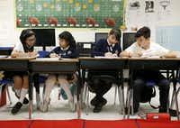Daniela Hernandez, (from left) Beatriz Ramirez, Briana Morales and Juan Pablo Ortiz work on math problems during class at Annie Webb Blanton Elementary in Dallas on May 17, 2018. (Nathan Hunsinger/Staff Photographer)