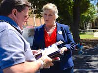 Voter Joe Pacetti meets with Lillian Salerno, Democratic candidate for the 32nd Congressional District, as she greeted voters outside Our Redeemer Lutheran Church in Dallas on Sunday.(Ben Torres/Special Contributor)