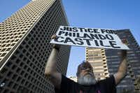 John Fullinwider held a sign as he joined other protesters at a rally in downtown Dallas on July 7, 2016. The rally followed the killing of Alton Sterling by police officers in Baton Rouge and Philando Castile in Minneapolis. On July 7, a gunman killed five police officers and wounded nine others.(Smiley N. Pool/Staff Photographer)