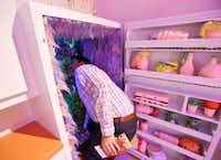 Wait, there's something on the other side of this fridge? Zane Harrington walks into the last room in the Sweet Tooth Hotel.(Nathan Hunsinger/Staff Photographer)