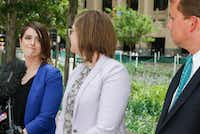 Mansfield ISD art teacher Stacy Bailey (from left), her wife, Julie Vazquez, and their lawyer, Jason C.N. Smith were together at Belo Gardens in downtown Dallas on May 8 to announce Bailey's discrimination lawsuit against the district. (File photo)