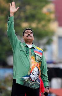 Venezuela's President Nicolas Maduro holds his hand up during his closing campaign rally in Caracas, Venezuela, Thursday, May 17, 2018. Maduro is seeking a new six-year mandate.(Ariana Cubillos/AP)