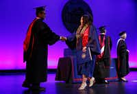 Wendy Birdsall walks across the stage at McFarlin Auditorium.(Nathan Hunsinger/Staff Photographer)