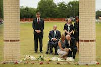 Texas Lt. Gov. Dan Patrick, Gov. Greg Abbott, and Texas first lady Cecilia Abbott pause and reflect after laying flowers at Santa Fe High School in Santa Fe, Texas Sunday May 20, 2018. On Friday morning May 18, 10 people were killed and 13 were injured after a shooting at Santa Fe High School.(Andy Jacobsohn/Staff Photographer)