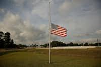 A flag flies at half staff on FM 646 in Santa Fe, Texas Sunday May 20, 2018.(Andy Jacobsohn/Staff Photographer)