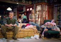Blake McNamara, left, plays Isaac, Cara Statham Serber plays his mother, Paige and Bob Hess plays his father, Arnold, in the regional premiere of Taylor Mac's 'Hir' at Stage West Theatre in Fort Worth.(Robert W. Hart/Special Contributor)