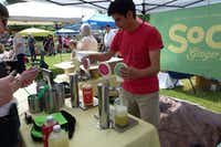 <p></p><p>Roger Nuñez wrings the last of the jalapeño-lime SoCo ginger beer out of the tap at Denton Community Market. </p><p></p>(Kim Pierce/Special Contributor)