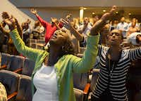 The congregation prays during the musical portion of a service.(Rex C Curry/Special Contributor)