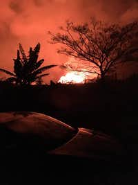 "Lava flows near John Davidson and David Burke's home near Pahoa, Hawaii.(<span style=""background-color: rgba(230, 93, 80, 0.2);"">Facebook</span>)"