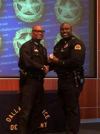 Aaron Bell (right) was promoted to lieutenant in 2013 by Chief David Brown.(Twitter)