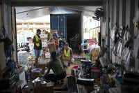 "Volunteers organize donated items at Puuhonua o Puna, a community organization serving evacuees and local residents affected by the Kilauea volcano eruption, in Pahoa, Hawaii, Tuesday, May 22.(<p><span style=""font-size: 1em; background-color: transparent;"">Tamir Kalifa</span></p>/The New York Times)"