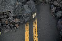 Hardened lava flow blocks Leilani Avenue in the Leilani Estates subdivision near Pahoa, Hawaii, on May 19, 2018.(Tamir Kalifa/The New York Times)