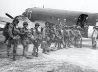 """Allied paratroopers enter a transport plane before taking off on the assault on German-occupied Holland during """"Operation Market Garden""""  Sept. 17, 1944.(British Official Photograph/AP)"""