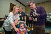 Thierry Hubert (right), CEO of Darwin Ecosystem, speaks with Amber Weigl and her husband Dan Weigl at South by Southwest in March. The Weigl family got day passes specifically to talk to Darwin Ecosystem and learn how it might be able to benefit their daughter Catherine Weigl, 7, who has Rett's Syndrome. <br>(Thao Nguyen/Special Contributor)