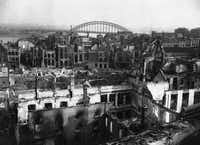 A view of bomb-wrecked and shell-shattered Nijmegen, Netherlands in February, 1945, with the famous bridge over the river Waal in the background. Only the shells of some houses are left in the town, which has seen some of the most fierce fighting of the war. Most of the buildings were razed to the ground.(Peter Carroll/AP)