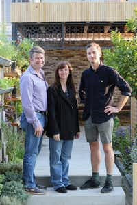 Hunter and Stephanie Hunt with designer Tom Massey in the Lemon Tree Trust Garden at the Chelsea Flower Show in London.(Britt Willoughby Dyer)