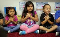 (From left) Kathya Rios, Giselle Reyes and Pablo Molina take part in a mindfulness exercise during class at Davis Elementary on Sept. 19, 2016 in Carrollton. Students at the school take part in a variety of activities aimed at helping keep them calm and focused both in the classroom and at home.(G.J. McCarthy/Staff Photographer)