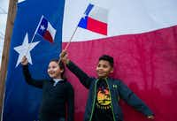 Gianna Bocanegra (left) and Chris Madrid posed for photos with Texas flags at TexFest on March 3, 2018, in downtown Carrollton.(Ashley Landis/Staff Photographer)