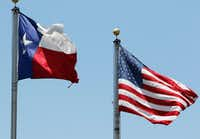 American and Texas flags are flown in Arlington on Monday, July 3, 2017. (David Woo/The Dallas Morning News)(David Woo/Staff Photographer)