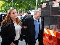 Film producer Harvey Weinstein, who is accused of sexual misconduct, arrives at Manhattan Criminal Court in New York City on Friday. (Anthony DelMundo/TNS)