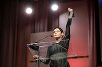 In this 2017 file photo, Rose McGowan raises her fist as she speaks during The Women's Convention at Cobo Center in downtown Detroit.(Junfu Han/Detroit Free Press)