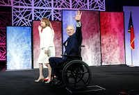 Gov. Greg Abbott, wife Cecilia and daughter Audrey Abbott wave to the crowd during the 2016 Texas Republican Convention at the Kay Bailey Hutchison Convention Center in Dallas, on Thursday, May 12, 2016. (Vernon Bryant/Staff Photographer)