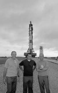 In this Sept. 8, 1969 file photo, Apollo 12 moon mission crewmen pose in front of their Saturn 5 space vehicle as the rocket was rolled out of the VAB at Cape Kennedy toward launch pad at complex 39. From left are Lunar Module Pilot Alan Bean; Command Module Pilot Richard Gordon and Commander Charles Conrad.  Bean, the Apollo and Skylab astronaut, fourth human to walk on the moon and an accomplished artist, has died. Bean, 86, died Saturday, May 26, 2018 at Houston Methodist Hospital in Houston.(Jim Bourdier/AP)