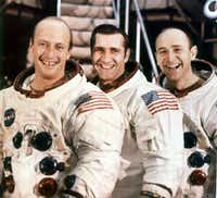 A photo provided by NASA of Alan Bean, right, with his Apollo 12 crewmates, Pete Conrad, left, and Richard Gordon. Bean, who became the fourth man to walk on the moon and turned to painting years later to tell the story of NASA's Apollo missions as they began receding into history, died May 26, 2018 at the age of 86.(NASA/NYT)