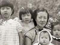 Tom Huang's grandmother poses for a family photo with four of her children in 1939 at the China-Vietnam border. Tom's mother is second from left.