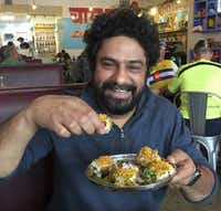 Chef Meherwan Irani enjoys his own authentic Indian street food at his Chai Pani restaurant. (Paul Ross/Special Contributor)