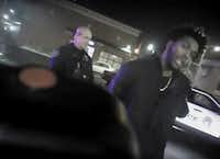 This Jan. 26, 2018 police body-camera footage released by Milwaukee Police Department shows NBA Bucks guard Sterling Brown as he talks to arresting police officers after being shot by a stun gun in a Walgreens parking lot in Milwaukee. The release comes as city officials who've viewed the videos have expressed concern about how officers conducted themselves. Even leaders of the police department have hinted the video may make them look bad.(AP)