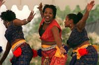 Benita Maxie, Ray-Nita Powell and Marsha Boone of Thoissan Nu Afrikan, a West African style dance group, performed at the Martin Luther King, Jr. Community Center's annual Juneteenth Celebration in 1999.(File Photo/Staff)
