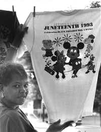 "<p><span style=""font-size: 1em; background-color: transparent;"">Pat Monroe, a Douglass Community Center volunteer, displayed a </span><span style=""font-size: 1em; background-color: transparent;"">T-shirt offered for sale during the Juneteenth celebration in 1993,  </span><span style=""font-size: 1em; background-color: transparent;"">which included a parade.</span></p>(File Photo/Staff)"