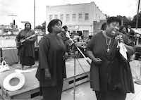 Rosetta Canady sang lead vocals and Minnie Wilson sang backup during a performance by the Starlight Gospel Singers of Greenville during the first Juneteenth Gospel Fest in Oak Cliff.(File Photo)