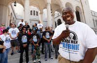 In this 2016 file photo, Bruce Carter,  founder of Black Men for Bernie, talks to supporters in front of Los Angeles City Hall. Traveling in a tour bus wrapped in this slogan, the group campaigned for Bernie Sanders.(Al Seib/LA Times)