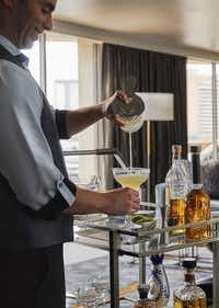 A mixologist at the Four Seasons Austin mixes a drink from the new room-service margarita cart.(Christian Horan Photography)