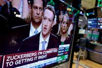 Facebook CEO Mark Zuckerberg appears on a television screen on the floor of the New York Stock Exchange as he testifies in the Senate in Washington in May.(Richard Drew/AP)