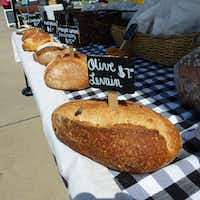 Village Baking Co. brings its popular, oven-fresh breads to St. Michael's Farmers Market so its regular customers don't have to drive across town to the bakery.(Kim Pierce/Special Contributor)