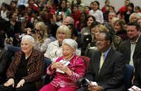 Legendary realtor Ebby Halliday listened to the Halliday Elementary School Choir at the dedication of Ebby Halliday Elementary School on her 101st birthday in Dallas on March 9, 2012. Mary Frances Burleson, president and CEO of Ebby Halliday,  is on the left, and Lew Blackburn, Dallas ISD trustee, is on the right. (File Photo/Staff )