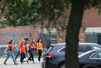 McKinney North High School students left the school after dismissal Monday.(Rose Baca/Staff Photographer)