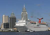 The Carnival Cruise Ship Fantasy moves down the Mobile River on its way to docking at the Alabama Cruise Ship Terminal in downtown Mobile, Ala. (2009 File Photo/Mobile Press-Register)