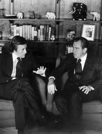 David Frost (left) talks with former President Richard Nixon in this March 1977 file photo prior to the taping of his interview with the former president. (The Associated Press)