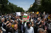 Iranian protesters chant during an anti-U.S. gathering after Friday prayer in Tehran.(Vahid Salemi/The Associated Press)