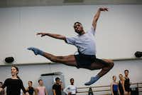 Ricardo Hartley, 19, a Booker T. Washington alumnus, warms up during first year ballet class at the Juilliard School. (Cassandra Giraldo/Special Contributor)