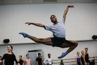 Ricardo Hartley, 19, a Booker T. Washington alumnus, warms up during first year ballet class at the Juilliard School.(Cassandra Giraldo/Special Contributor)