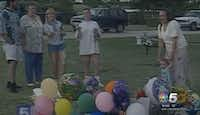 An image from a rebroadcast of the 1996 video NBC5 captured of Darlie Routier spraying Silly String on her sons' graves.(KXAS-TV (NBC5))