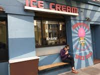 A customer enjoys her ice cream at Bi-Rite Creamery on 18th Street in San Francisco's Mission area.(Sheryl Jean/Special Contributor)
