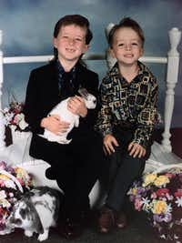 Devon Routier (left) and his brother Damon pose in a 1995 Easter photo in Rowlett. Their mother, Darlie Routier, was sentenced to death for the murder of Damon Routier. (The Associated Press)